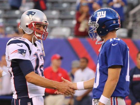 New England quarterback Tom Brady and New York Giants