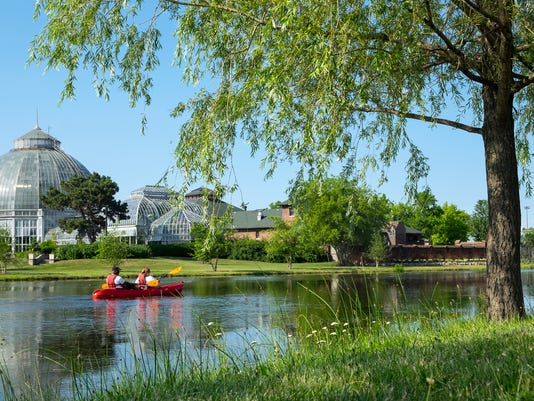 500px Photo ID: 218499063 - A couple kayaks along the pond in front of the Anna Scripps Conservatory on Belle Isle in Detroit in July.