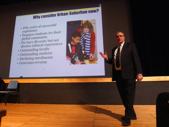 Spencerport schools Superintendent Mike Crumb explains his proposal for the Urban-Suburban program in his district.