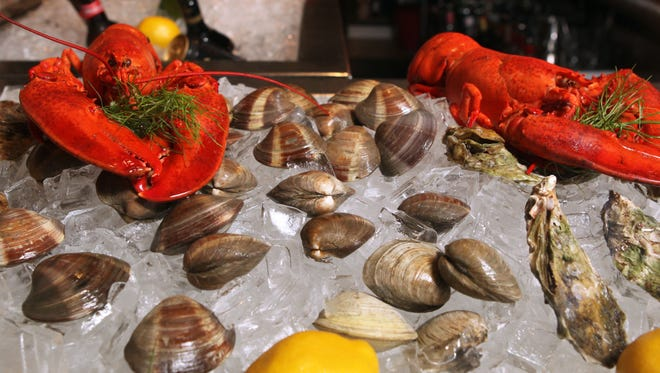 Lobsters in a  raw bar.