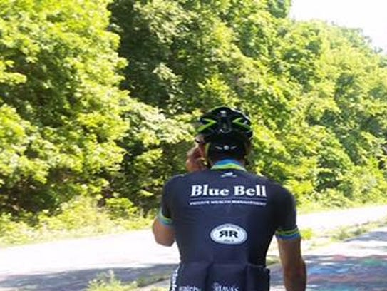 Jared Fenstermacher rides his bicycle on a 3,000-mile