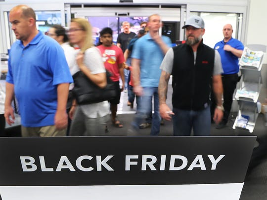 Thanksgiving Day shoppers hit a Best Buy in north Scottsdale,