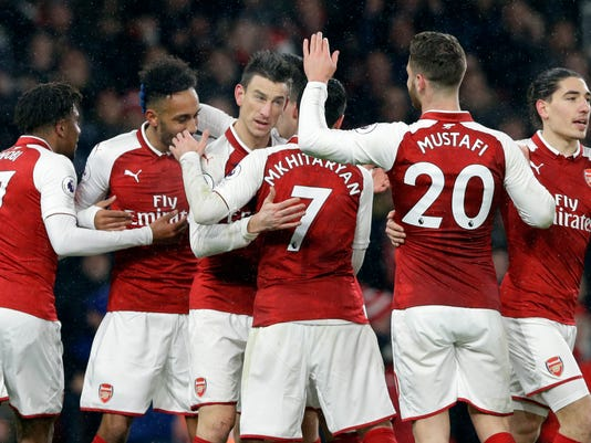 Arsenal's Laurent Koscielny, third left, celebrates with teammates after scoring his side's second goal during the English Premier League soccer match between Arsenal and Everton at the Emirates stadium in London, Saturday, Feb. 3, 2018. (AP Photo/Alastair Grant)