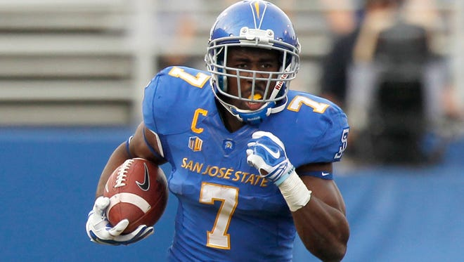San Jose State Spartans running back Tyler Ervin (7) runs the ball for a 41 yard gain against the New Mexico Lobos in the second quarter at Spartan Stadium.
