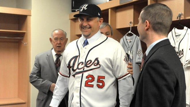 Phil Nevin, center, is introduced as the Aces' second manager in team history during a news conference on Nov. 4, 2013.