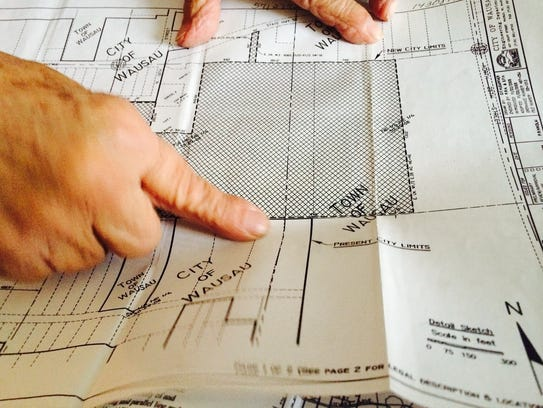 Virginia Zastrow shows her property on a map with land
