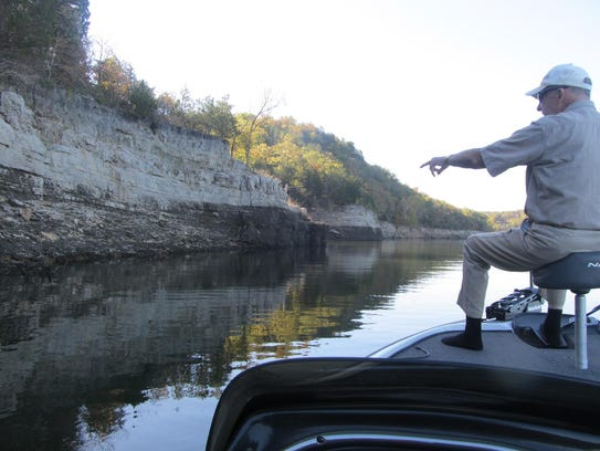 Charlie Campbell points out a bluff on Bull Shoals