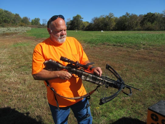 Dean Shaulis gets ready to fire his crossbow.