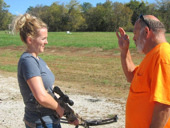 Dean Shaulis gives some pointers to Arica Johns on