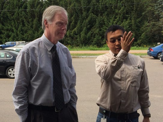 Will Hsu, right, gives a tour of Hsu's Ginseng Enterprises