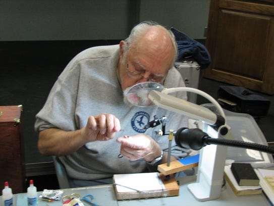 An expert angler ties a fly at a previous Fly Fishing
