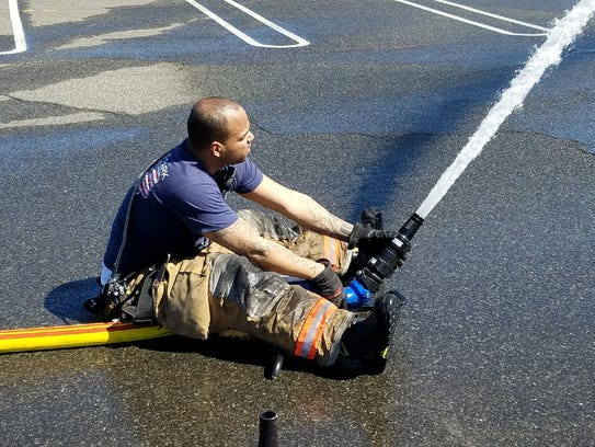 Freddie Montanez shown a training drill in Ridgefield