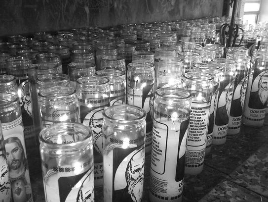 Votive candles adorn the shrine of Don Pedrito. Pilgrims