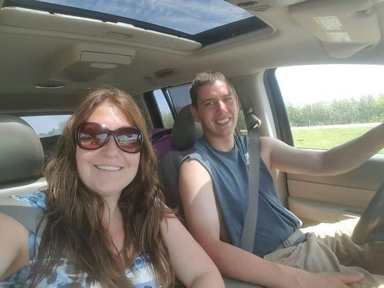 Misty Cook sits in the car with Zack Frazer, her boyfriend