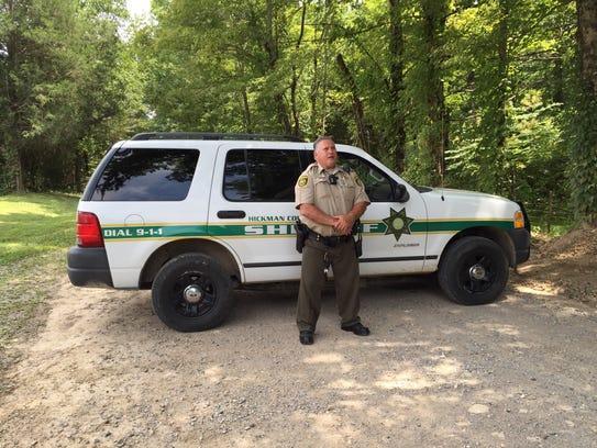 Hickman County Sheriff's Office Deputy Ken Daron blocks