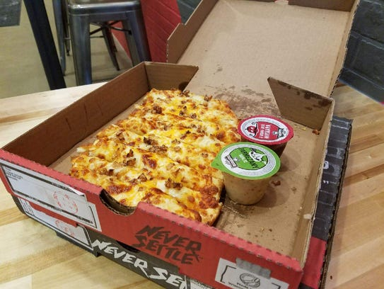 Toppers pizza sells specialty cheesy bread sticks called