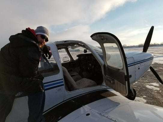 Dustin Shaffer boards his air taxi used to fly passengers