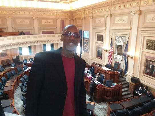 Former Tennessee and Washington Redskins quarterback Tony Robinson stands in the Virginia General Assembly on Tuesday as he and Anthony Sagnella were present to hear the passing of a resolution that honored the contributions of the replacement players during the 1987 season during which Washington won the Super Bowl.