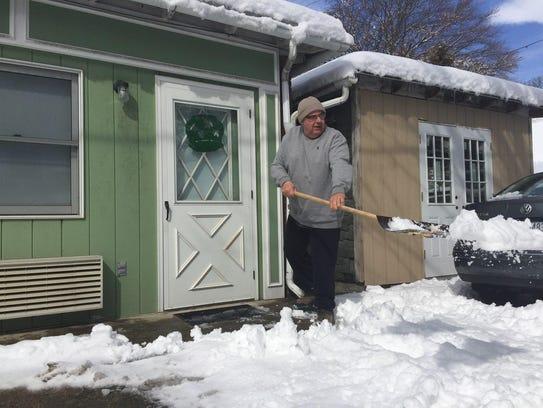 Jeff Herbe, of Locust Street in Lebanon, shovels snow