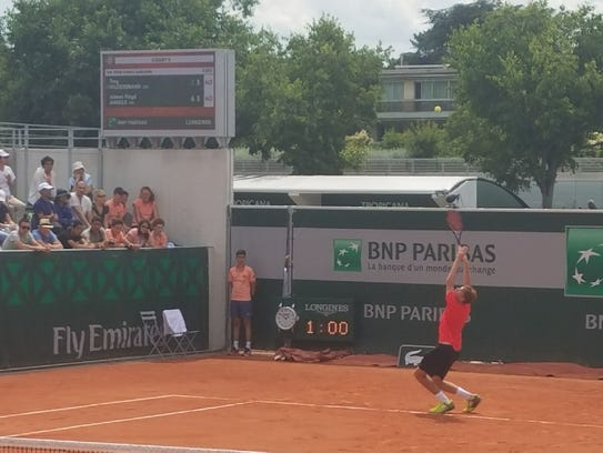 Trey Hilderbrand serves at the French Open juniors