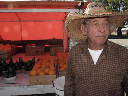 This Feb. 5, 2016, photo shows 82-year-old farmer Frank Olvera selling oranges, avocados and raisins from his pickup truck parked along a road in Fresno County. Olvera raises the produce on his small farm. A newly released state report shows California farmers reaping record sales of $53.5 billion in 2014, the same year Gov. Jerry Brown declared the state in a drought emergency and launched what became mandatory conservation for cities and towns. (AP Photo/Scott Smith)