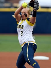 Michigan pitcher Megan Betsa throws a first inning pitch against Valparaiso. Betsa struck out nine and allowed one hit in the five-inning victory.