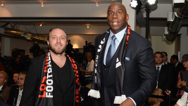 Minority owners Chad Hurley and Magic Johnson at a press conference announcing new MLS team.