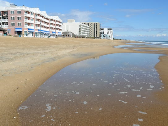 Tide pools form on Rehoboth Beach just after high tide
