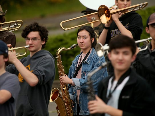 Saxophone player Caitria O'Connor, 15, keeps her eyes