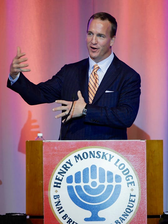 "Denver Broncos quarterback Peyton Manning speaks at the B'nai B'rith sports banquet in Omaha, Neb., Thursday, May 15, 2014. Manning's pre-snap shouts of ""Omaha"" put the Midwestern city in the national spotlight during the NFL playoffs. (AP Photo/Nati Harnik)"