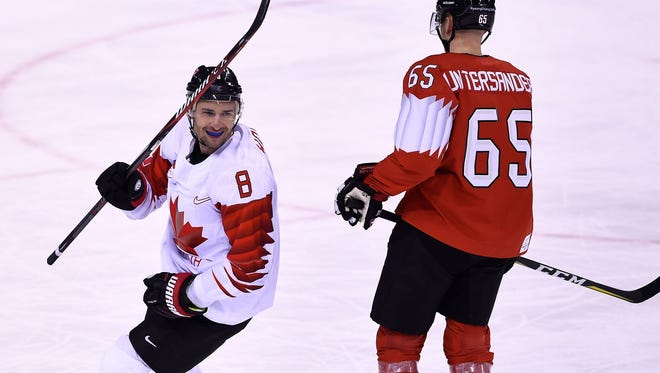 Canada's Wojtek Wolski scored a pair of goals in Thursday's win over Switzerland. Wayne Simmonds is cheering him on from afar.