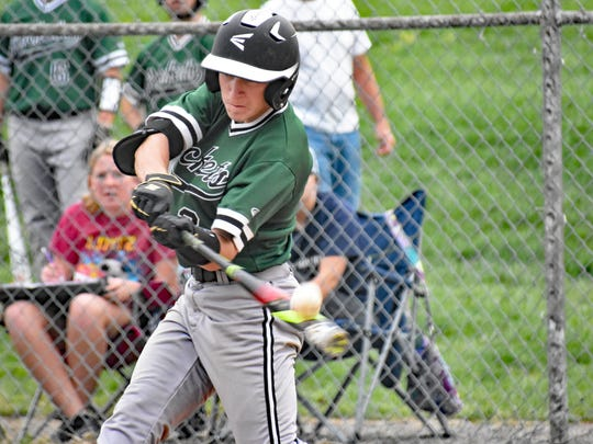 James Buchanan's Jared Pine gets a hit off the end of his bat during a Mid Penn Colonial Division game against Greencastle-Antrim on Thursday, April 20, 2017. G-A won 3-0 in a shortened game due to rain.
