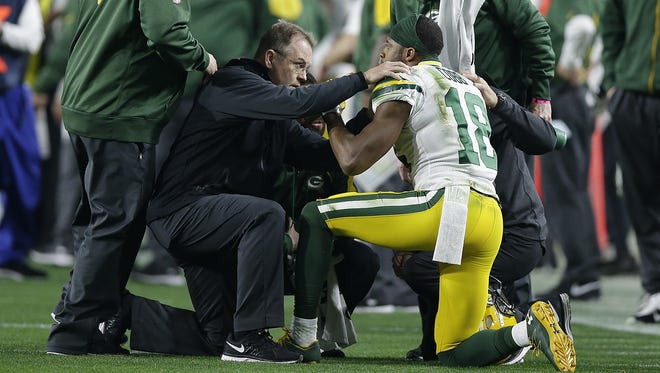 Green Bay Packers receiver Randall Cobb (18) is attended by the medical staff after getting injured during their NFC divisional playoff game at University of Phoenix Stadium.