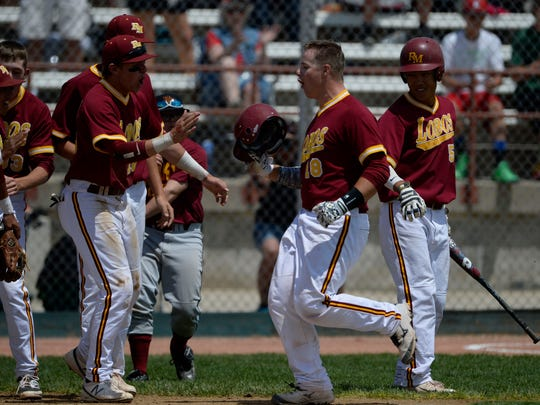 Rocky Mountain High School catcher, Garrett Hammer comes home after belting a two-run homer against Cherry Creek in the first inning of play Friday in Denver.