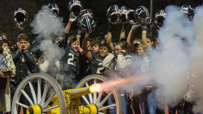 Pueblo South High School football helps fire the cannon for the first time after defeating East in the 44th Cannon Gamemat Dutch Clark Stadium.