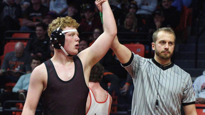 Dakota's Andrew Wenzel looks into the crowd after winning the Class 1A 170-pound wrestling championship on Feb. 16, 2019, at the State Farm Center in Champaign. Wenzel, who just committed to wrestle at the Air Force Academy, went on to place second at state the next year.