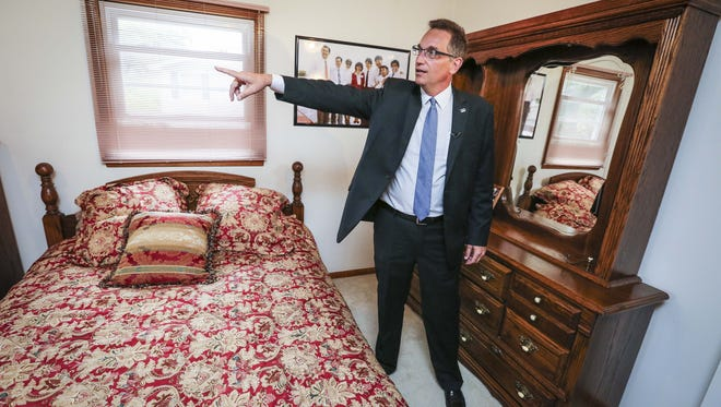 Gary Dvorchak, currently a businessman in Beijing, China, shows off his childhood room Sept. 17, 2015, in Muscatine, Iowa, where President Xi Jinping slept during a visit thirty years ago. Thursday the home was officially opened as the Sino-U.S. Friendship House. The house was sold and has been remodeled since he stayed the there.