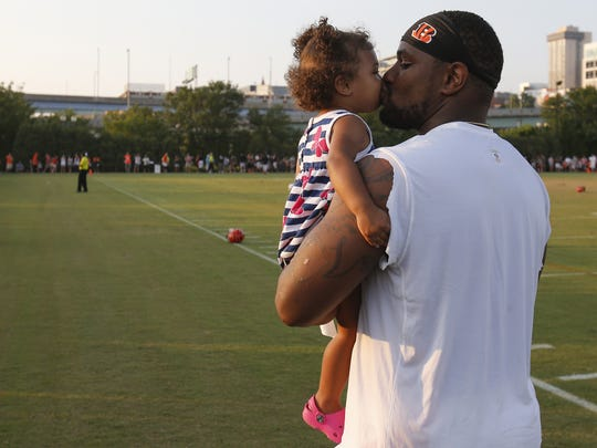 Cincinnati Bengals outside linebacker Vontaze Burfict (55) kisses his daughter at the conclusion of practice during Cincinnati Bengals training camp, Friday, Aug. 5, 2016, on the practice fields next to Paul Brown Stadium in Cincinnati.