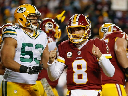 Washington Redskins quarterback Kirk Cousins (8) celebrates running back Rob Kelley's touchdown during the second half of an NFL football game against the Green Bay Packers in Landover, Md., Sunday, Nov. 20, 2016. (AP Photo/Alex Brandon)