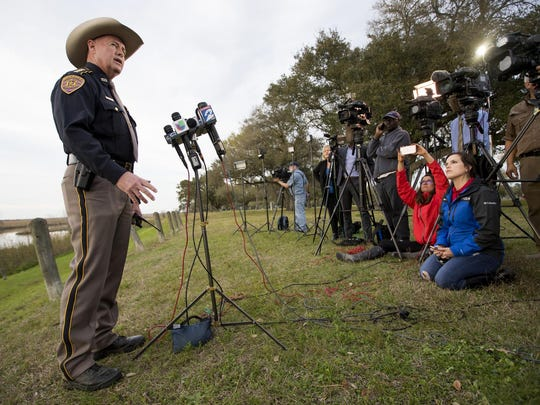 Chambers County Sheriff Brian Hawthorne gives an update on a plane crash in Trinity Bay during a news conference in Anahuac, Texas, Feb. 23, 2019. A Boeing 767 cargo jetliner heading to Houston with a few people aboard disintegrated after crashing Saturday into the bay east of the city, according to a Texas sheriff.