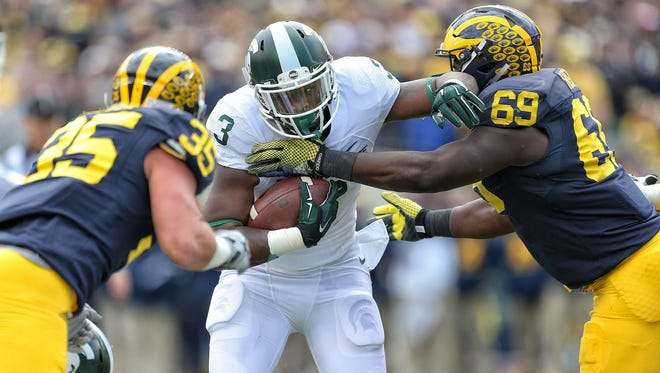 Michigan State running back LJ Scott (3) carries the ball against Michigan on Oct. 17, 2015.