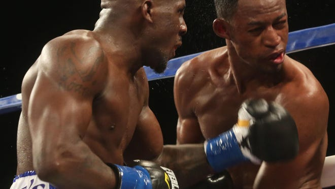 Tevin Farmer of Philadelphia delivers the knockout shot against Daulis Prescott of Barranquilla, Colombia in the eighth round during their bout on Saturday.