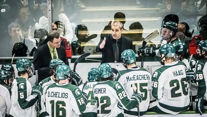 MSU Hockey Head Coach Tom Anastos instructs his team as Penn State regained full strength and MSU leading 3-2 with 21 seconds remaining in their game Saturday January 18, 2014 in East Lansing.