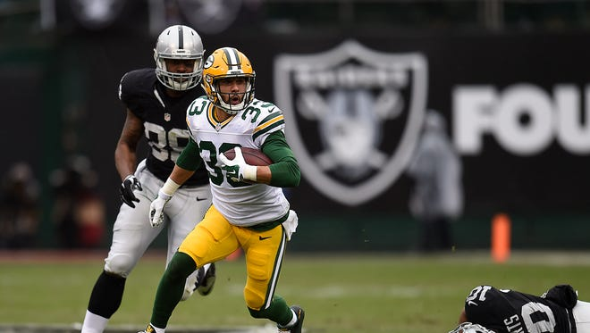 Green Bay Packers cornerback Micah Hyde (33) runs with the ball after making an interception against the Oakland Raiders at O.co Coliseum.
