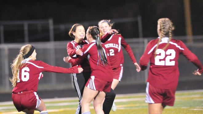 Teammates congratulate Asheville High's Sarah Sirkin after she scored a goal Monday night at Reynolds.