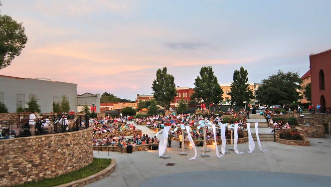 A crowd fills Carolina Wren Park in downtown Andersn for Much Ado About Nothing, a William Skakespeare play set in the 1940's, presented by The City of Anderson & 24 Hour Musical, Inc. last year.