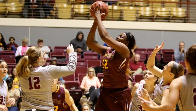 Midwestern State's Chelsea Adams goes for two against Oklahoma Christian in the Ashbrook Classic Saturday, Nov. 11, 2017, in D.L. Ligon Coliseum at MSU. The Mustangs defeated the Lady Eagles 72-68.