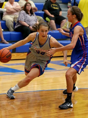 Indiana's Ali Patberg drives around Kentucky's Logan Fraley during the Junior All-Star Game, Friday, June 6, 2014, at Greenfield Central High School.