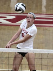 Freshman Trinity Miller of Fairfield makes a dig off