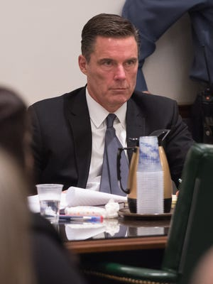 Patrick Collins, an attorney representing Derrick Powell, listens to arguments in the case of D. Powell vs. State at the Delaware Supreme Court in Dover.